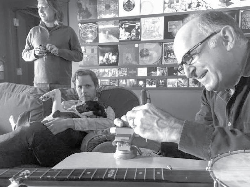 From left, music producer Jon Neufeld, recording engineer Adam Selzer and musician Steve Einhorn are part of the team bringing new life to Woody Guthrie's collection of songs.